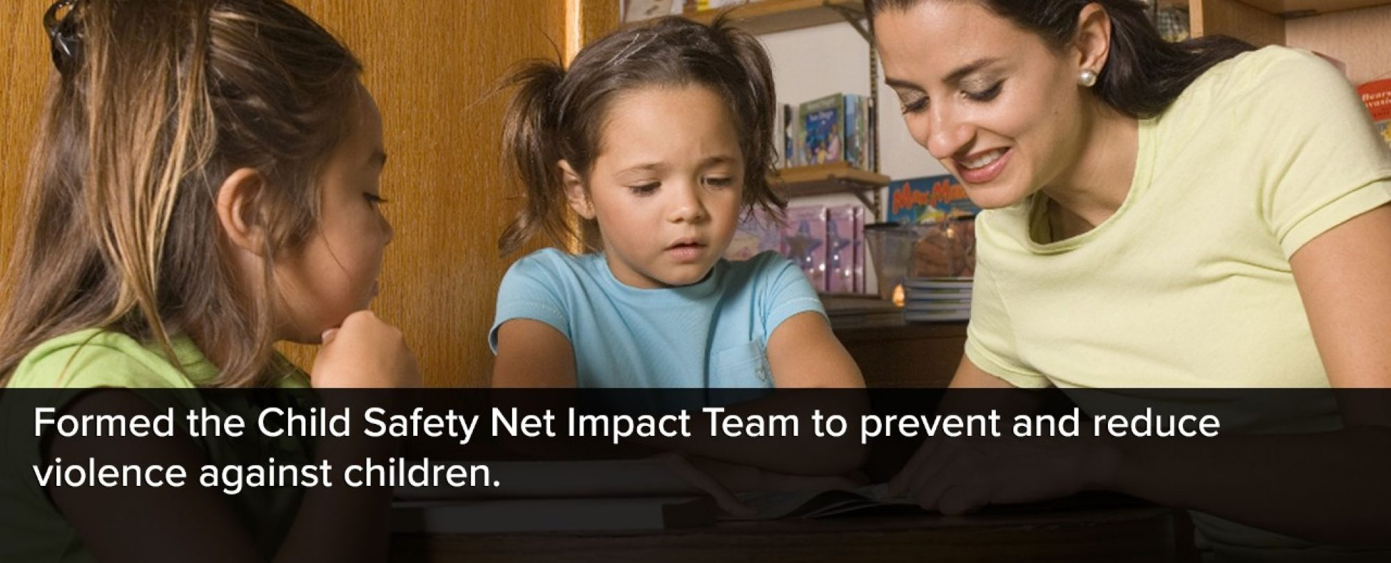 Photo of caregiver with two young girls. Denver formed the Child Safety Net Impact Team to prevent and reduce violence against children.