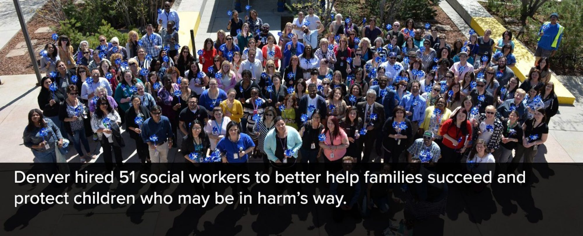 Photo of Denver human Services staff. Denver hired 51 social workers to better help families succeed and protect children who may be in harm's way.