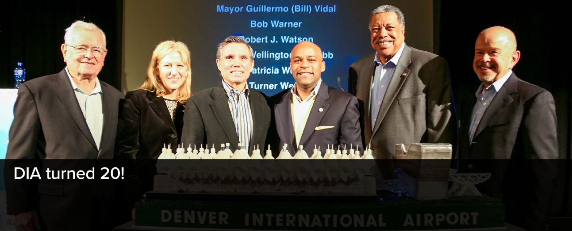 Photo of Mayor Michael B. Hancock, with others, to celebrate Denver International Airport's 50th birthday.
