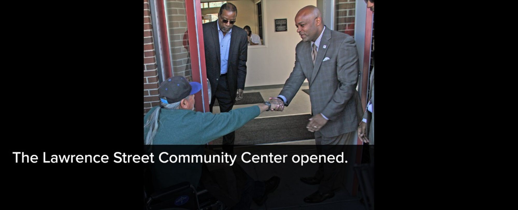 Photo of Mayor Michael B. Hancock greeting a visitor to the new Lawrence Street Community Center