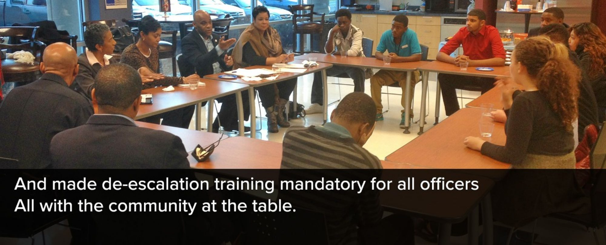 Photo of Mayor Michael B. Hancock at a community table discussion around mandatory de-escalation training. De-escalation training was made mandatory for all officers