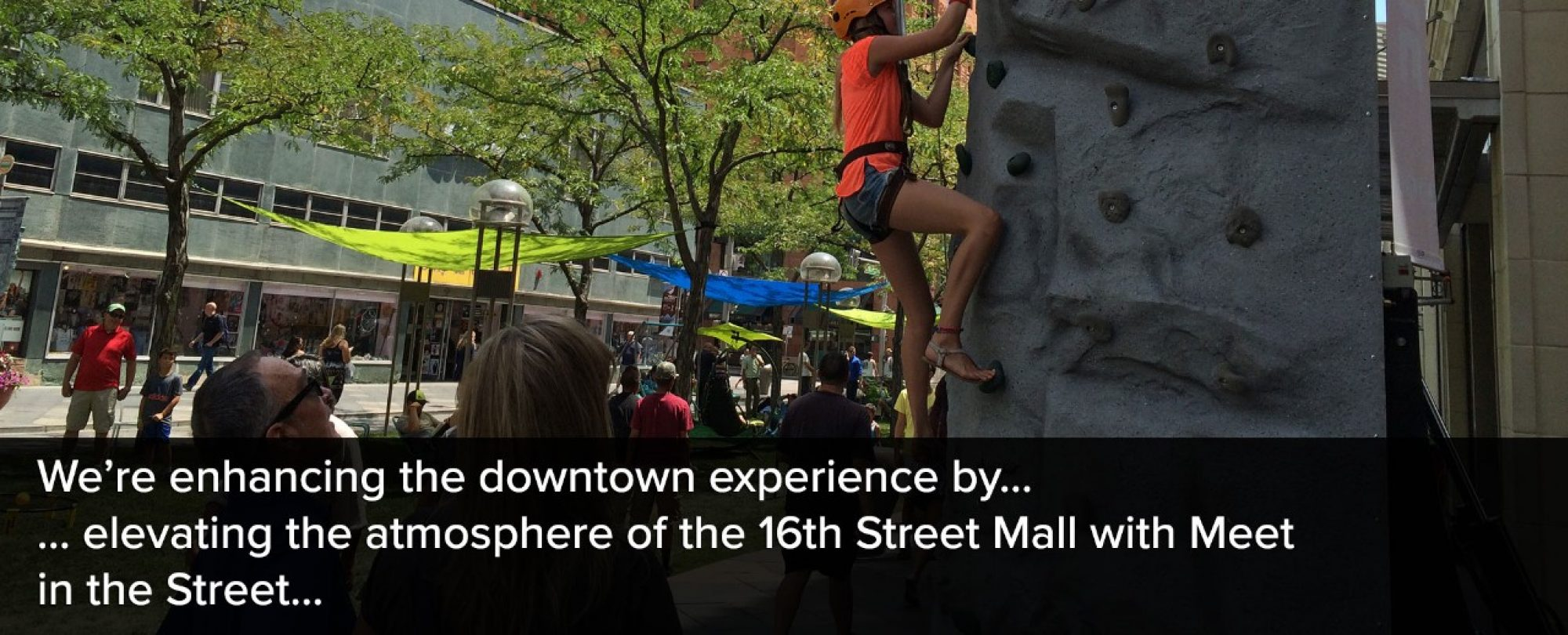 Photo of a climbing wall during a 16th Street Mall 'Meet in the Street' event as part of an effort to enhance the Downtown Denver experience