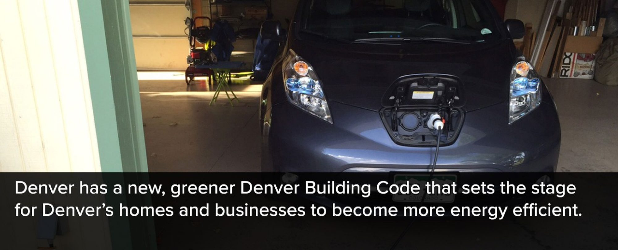 Photo of a plugged in electric car. Denver has a new, greener Denver Building Code that sets the stage for Dnever's homes and businesses to become more energy efficient
