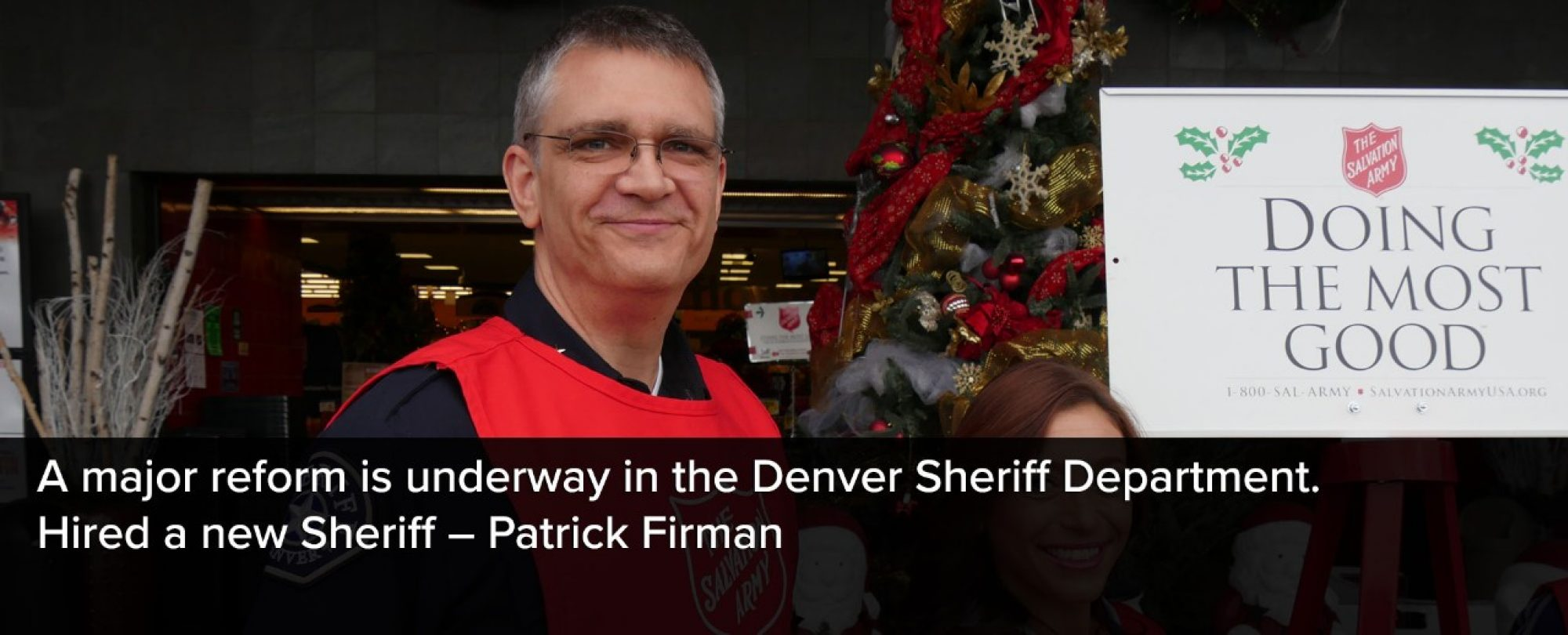 Photo of new Denver Sheriff, Patrick Firman volunteering in the community over the holidays. A major reform is underway in the Denver Sheriff Department including the hiring of Sheriff Patrick Firman.