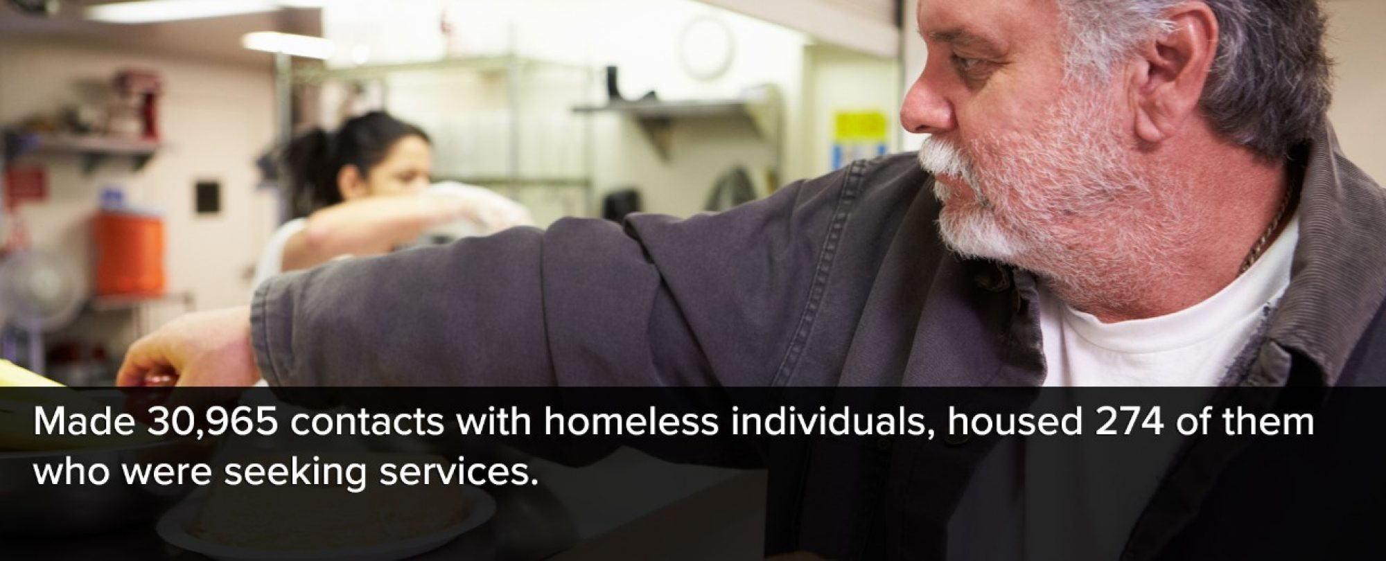 Photo of man recieving meal at a local homeless shelter. Denver made 30,965 contacts with homeless individuals and housed 274 of them who were seeking services.