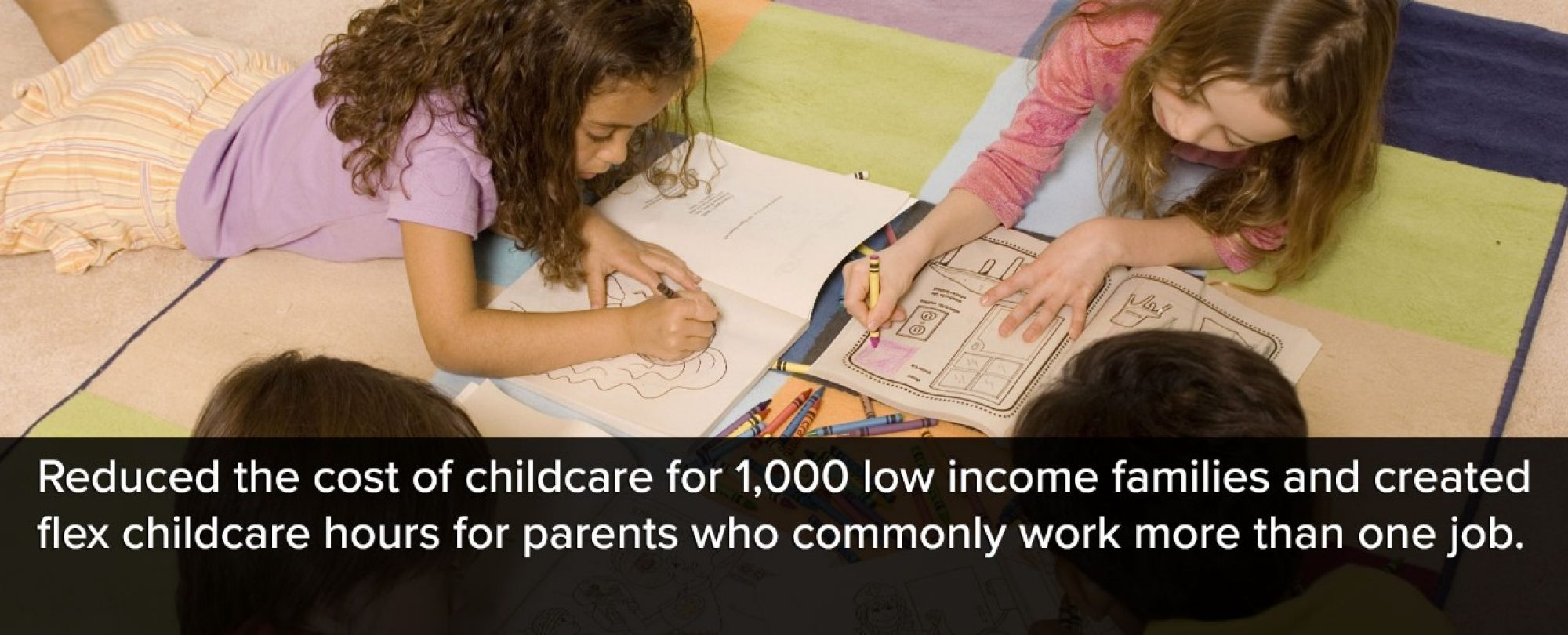 Photo of young children coloring. Denver reduced the cost of childcare for 1,000 low income families and created flex childcare hours for parents who commonly work more than one job.
