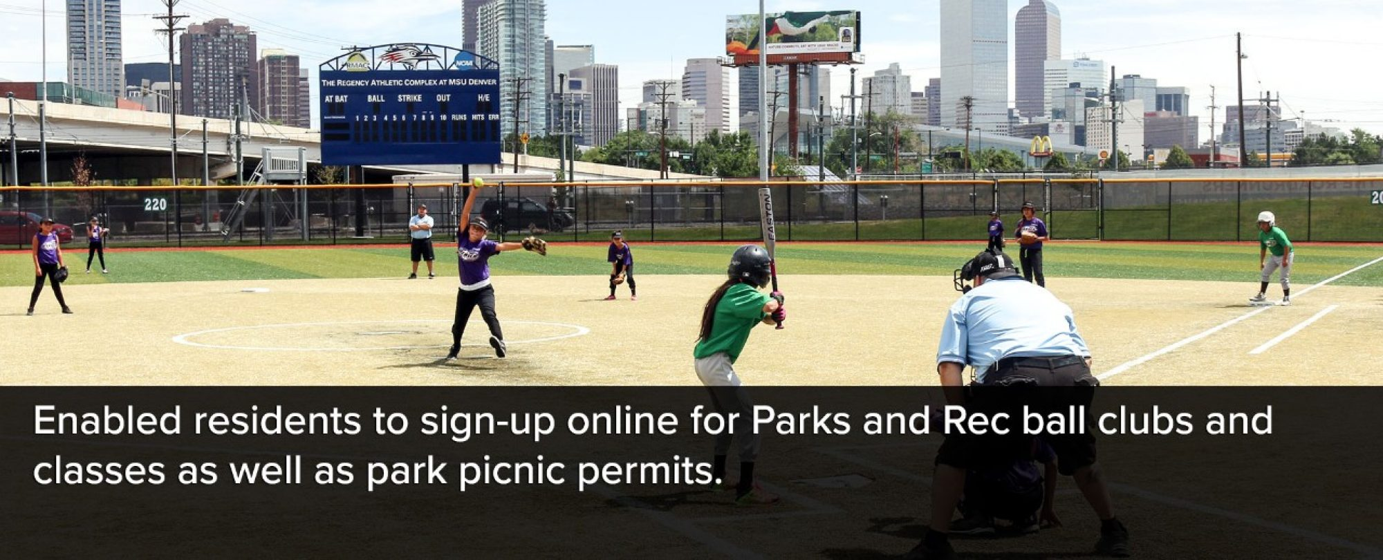 Photo of a local Denver Parks and Recreation ball park baseball game. Denver enabled residents to sign-up online for Parks and Rec ball clubs and classes as well as park picnic permits.