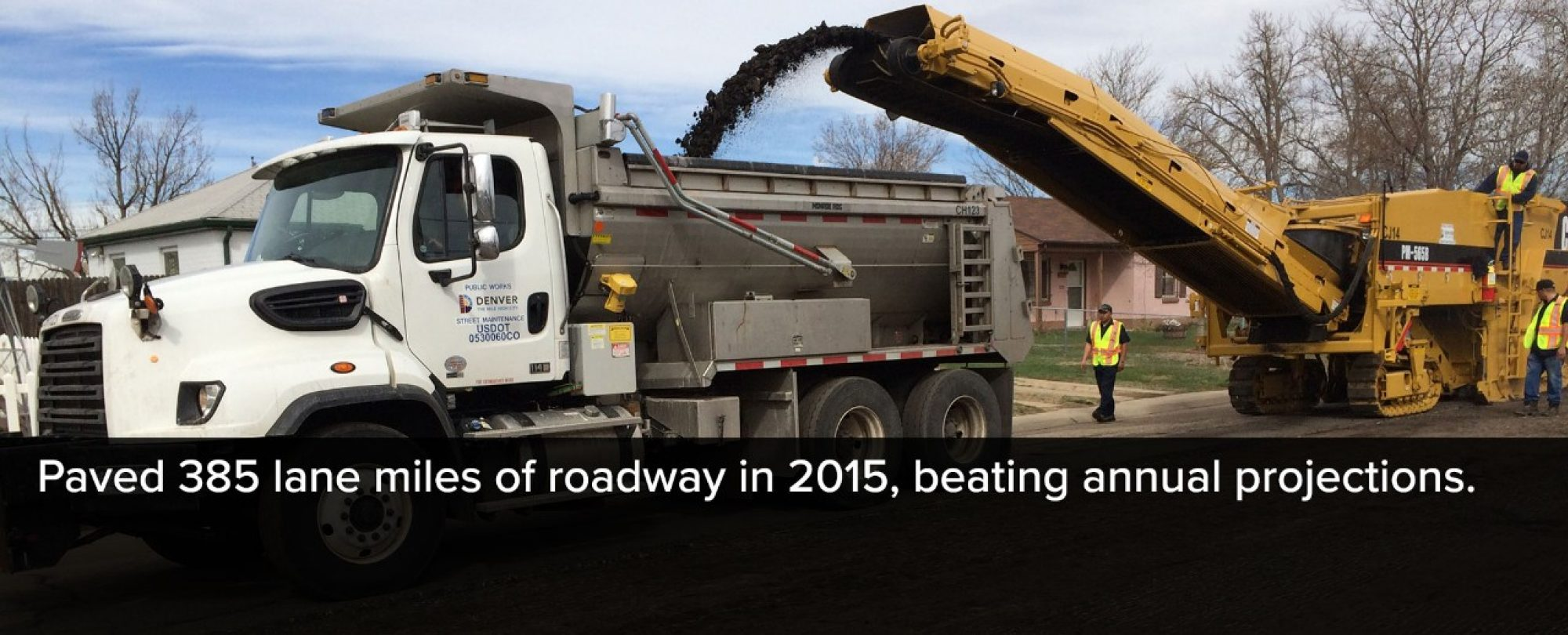 Photo of a city paving truck. Denver Public Works paved 385 lane miles of roadway in 2015, beating annual projections.