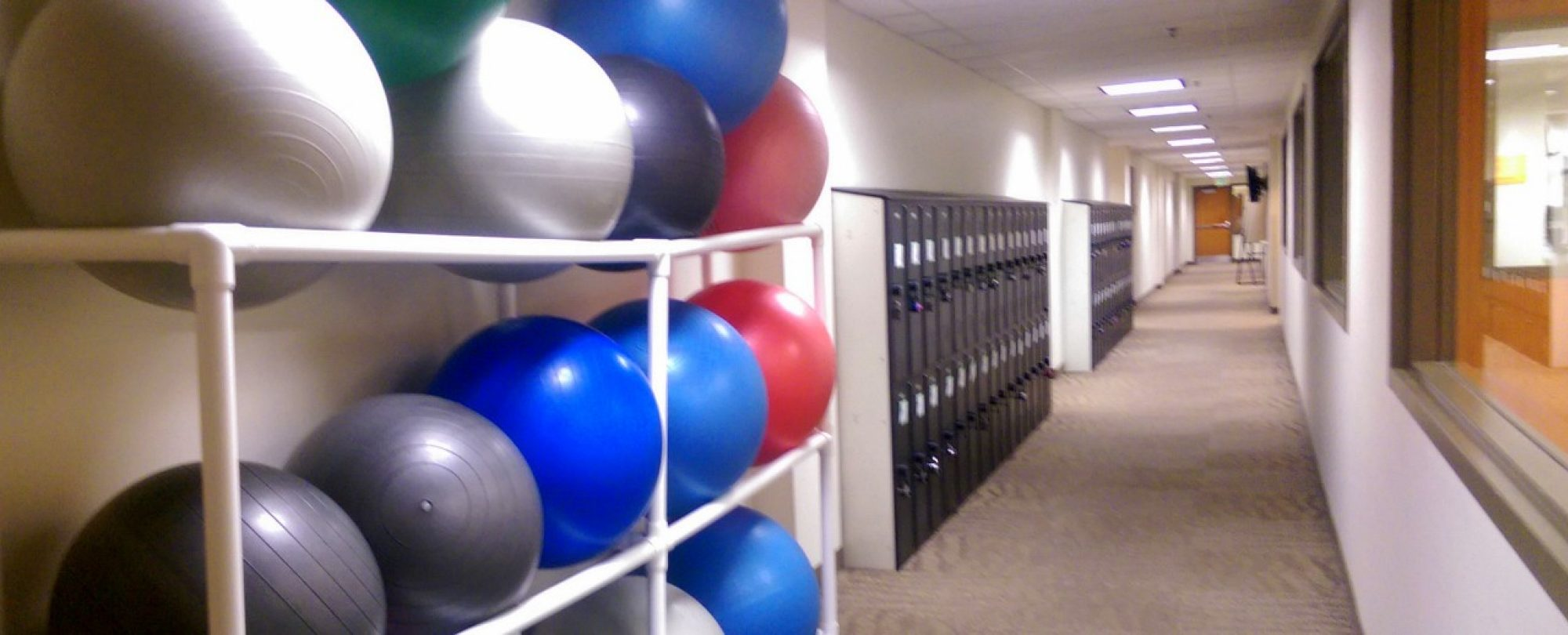 photo of yoga balls stacked in hallway