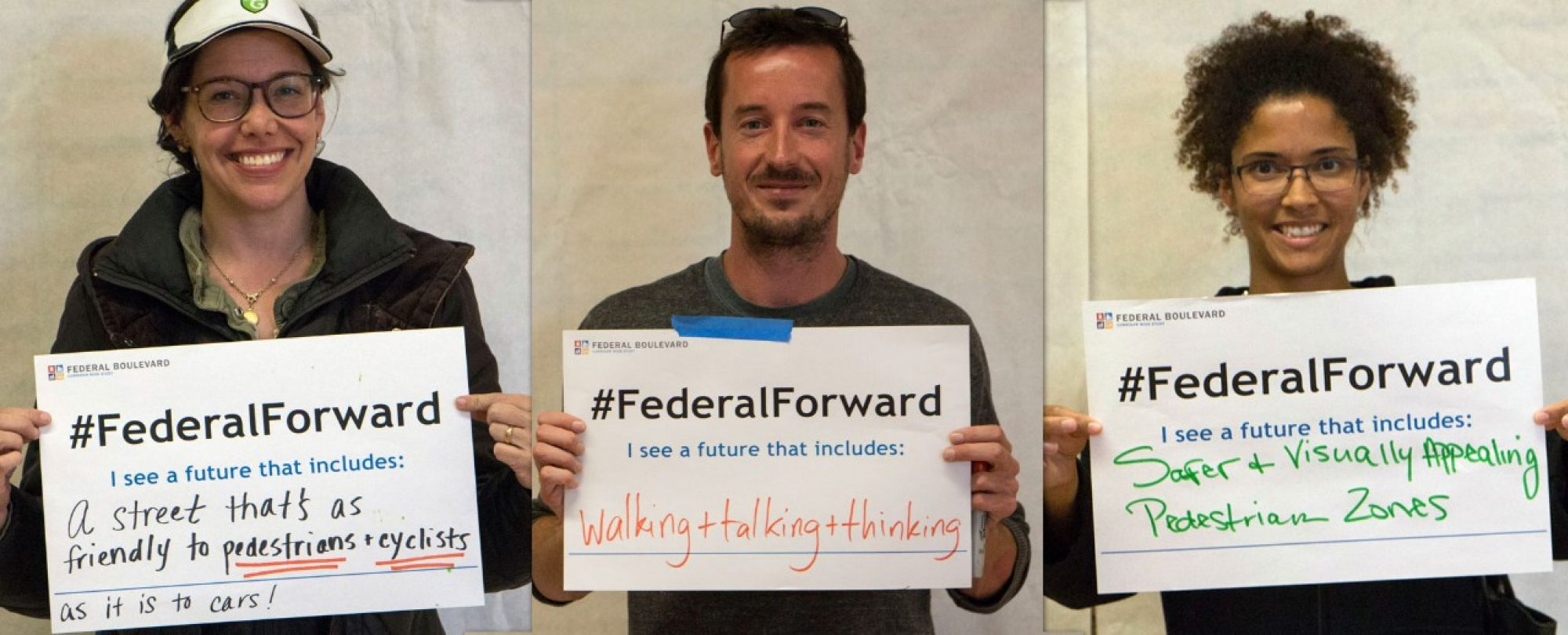Meeting attendees holding #Federal Forward signs: