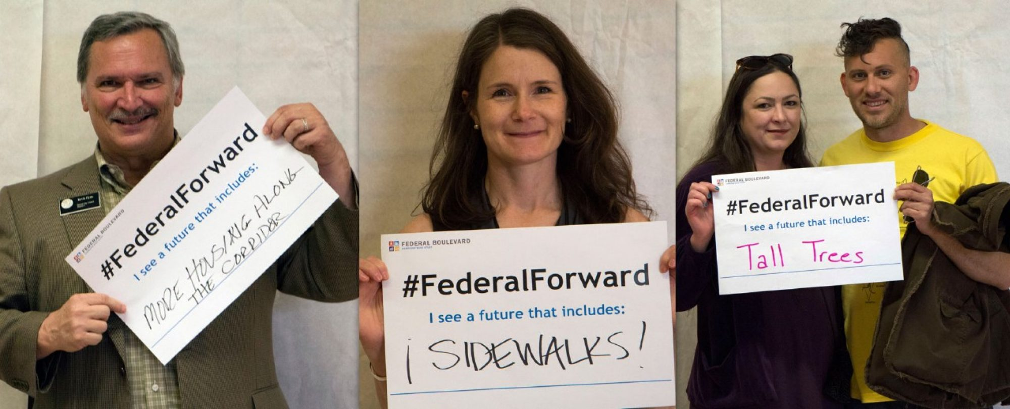 residents holding #FederalForward signs: