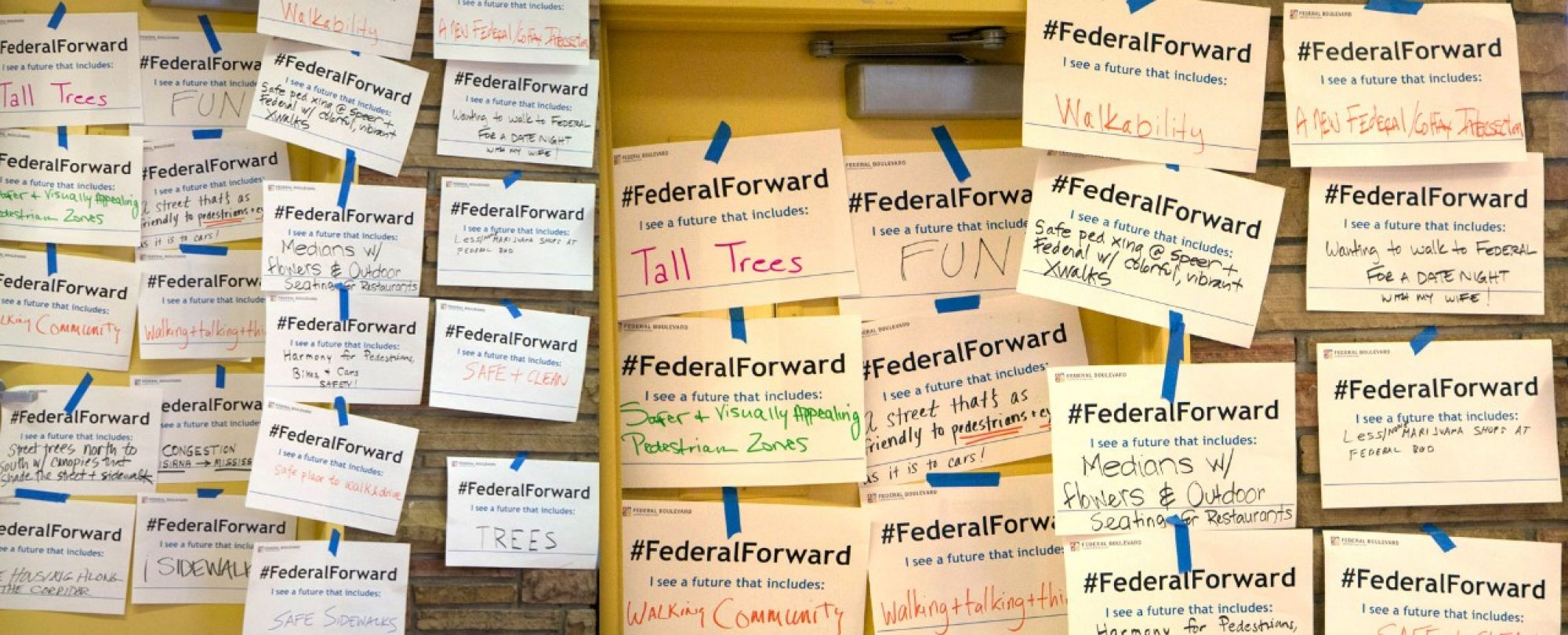 wall of #FederalForward signs for review