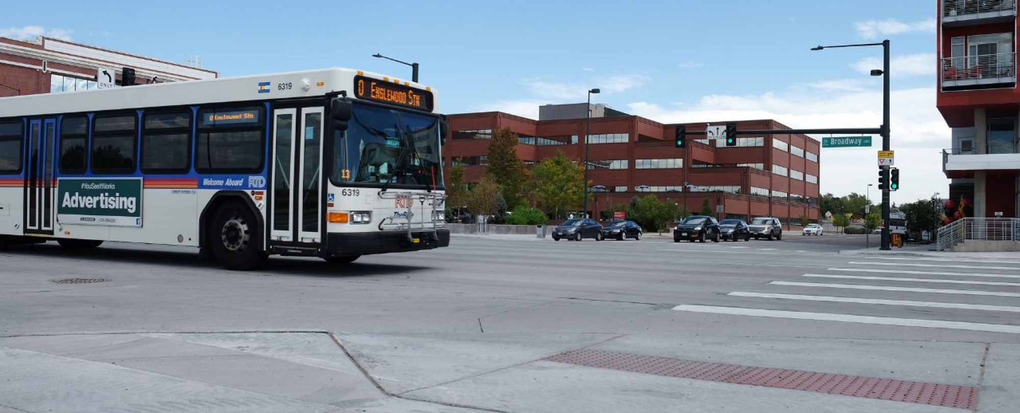 bus in intersection on South Broadway on new roadway