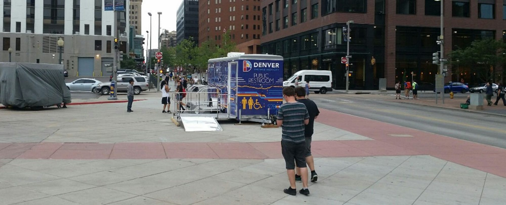visitors exiting mobile restroom unit along 16th Street Mall