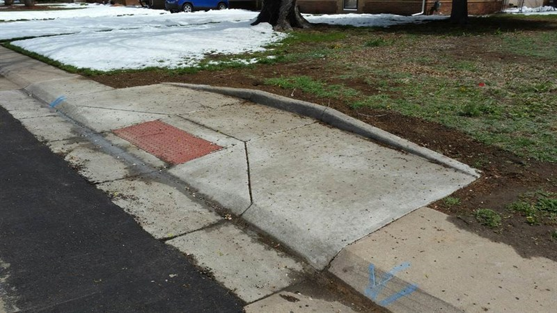 ADA ramp installed at mid block with wider compliant sidewalk area for turning