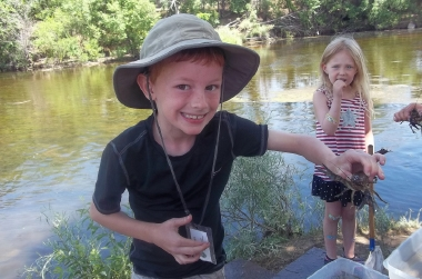 Kids catching crawfish is the South Platte RiverPlace area