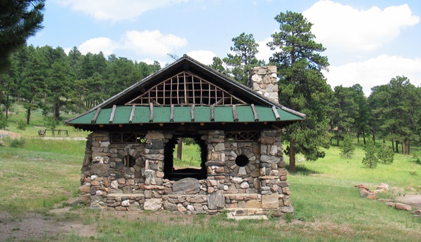 historic stone shelter in a meadow in Fillius Park