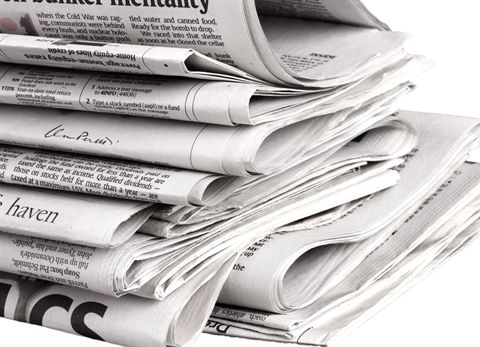 A pile of newspapers with a white background